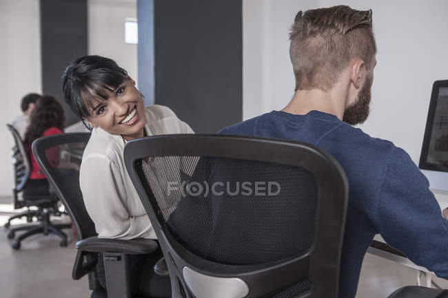 Creative professionals working together in office — Stock Photo