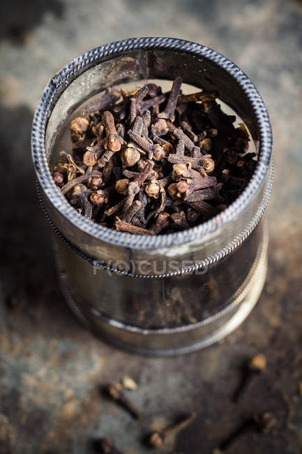 Closeup view of dried cloves in glass — Stock Photo