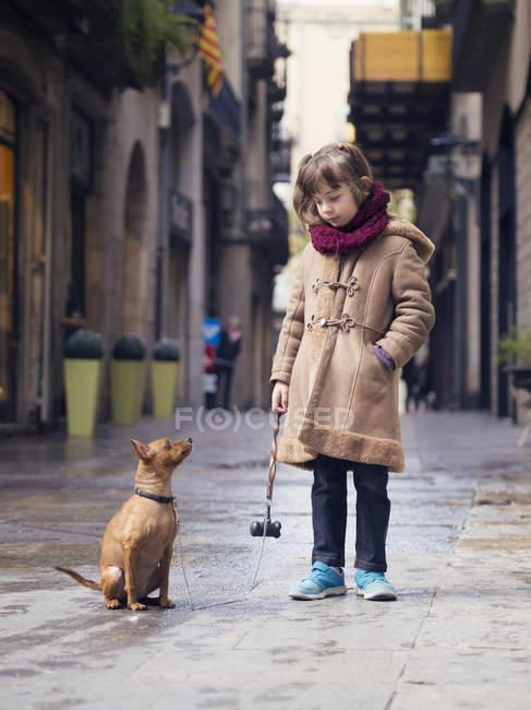 Portrait of little girl and her Miniature Pinscher — Stock Photo