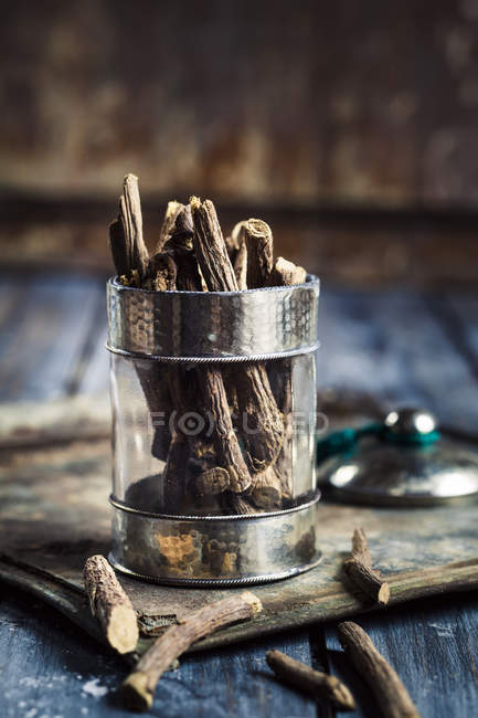 Closeup view of dry liquorice roots in glass — Stock Photo
