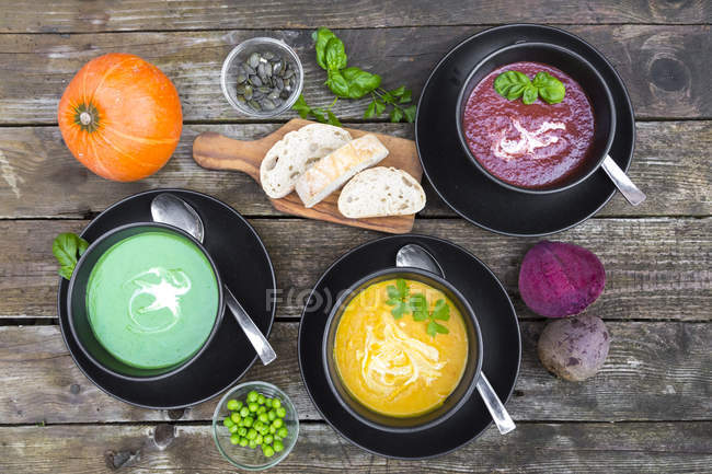 Pea soup, beetroot and pumpkin soup in bowls — Stock Photo