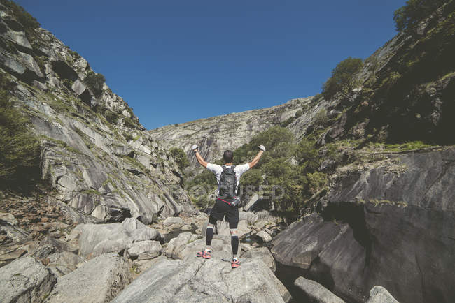 Ultra trail runner enjoying landscape with hands raised — Stock Photo