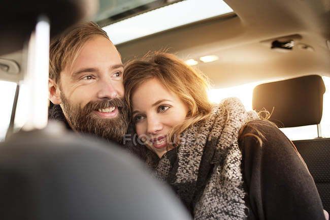 Couple cuddling in car — Stock Photo