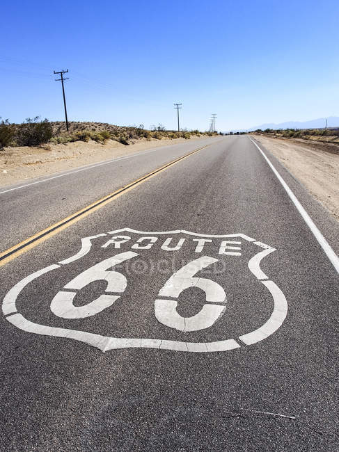 USA, California, Route 66 with sign on road, desert — Stock Photo