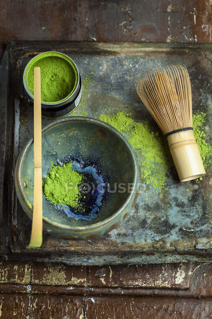 Closeup view of matcha powder with whisk and chashaku — Stock Photo
