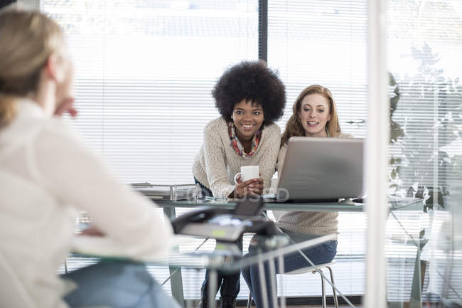 Three colleagues working in modern office — Stock Photo