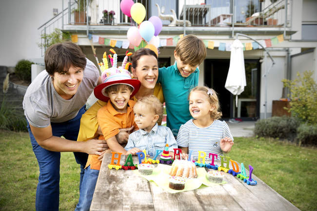 Happy family having birthday party in garden — Stock Photo