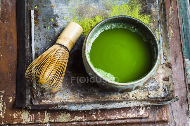 Closeup view of chasen and chawan of matcha tea — Stock Photo