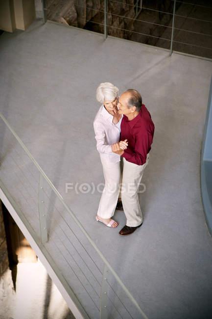 Overhead view of Happy senior couple dancing — Stock Photo