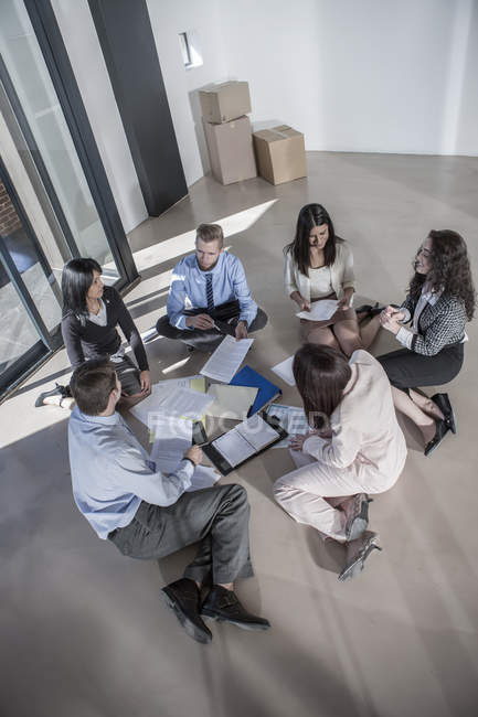 Businesspeople working in new open office — Stock Photo