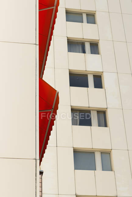 Germany, Duesseldorf, red canvas blind at high-rise residential building — Stock Photo