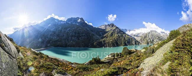 Switzerland, Canton of Uri, Goeschenen, Goescheneralpsee, Glascier Dammastock  during daytime — Stock Photo