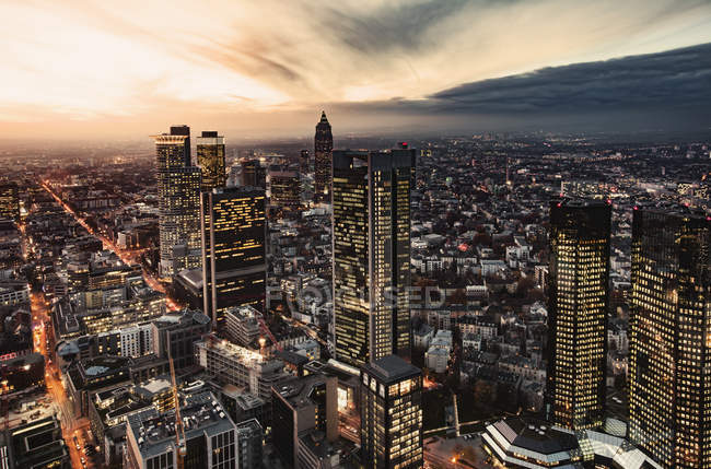 Germany, Frankfurt, elevated view to the lighted city at evening twilight — Stock Photo