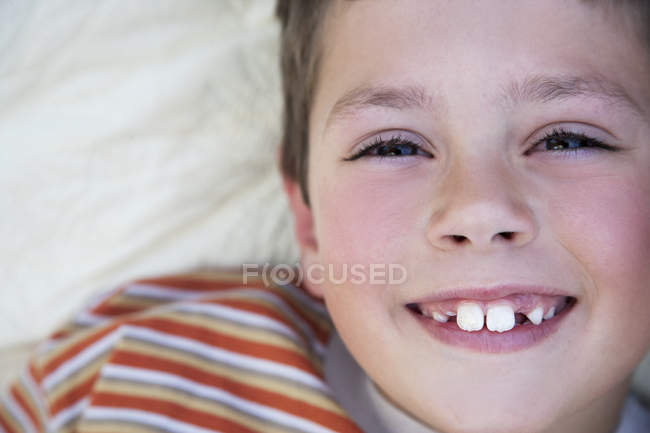 Portrait of smiling little boy with tooth gap — Stock Photo