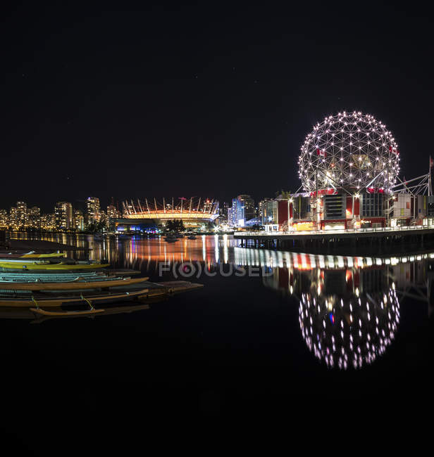 Canada, Vancouver, view to BC Place Stadium and Science World at Telus World of Science illuminated at night — Stock Photo