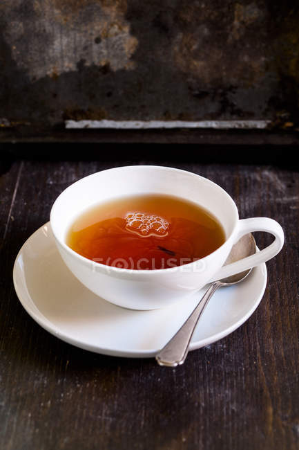 Closeup view of black tea in white porcelain cup — Stock Photo