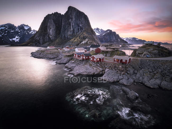 Norway, Lofoten, Hamnoy in the evening and view of rocks over water — Stock Photo