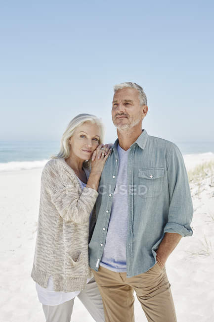 Mature Couple standing at the beach — Stock Photo