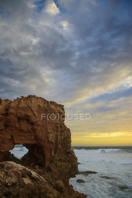 Australia, natural arch at sunset over water — Stock Photo