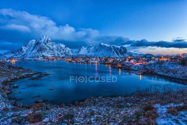Norway, Lofoten, aerial view of illuminated Reine at blue hour — Stock Photo