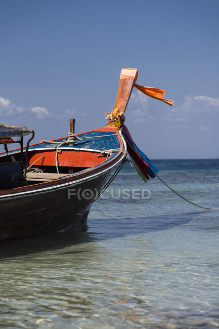 Thailand, Koh Phi Phi Island, long-tail boat on water surface — Stock Photo