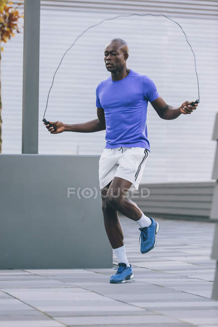 Athlete skipping rope outdoors — Stock Photo