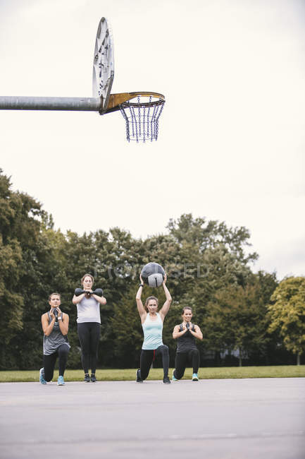 Four women having outdoor boot camp workout — Stock Photo