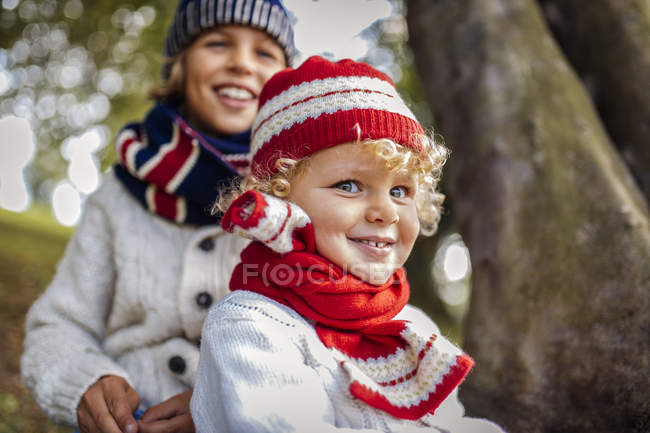 Portrait of blond little boys and his brother in the background wearing fashionable knit wear in autumn — Stock Photo