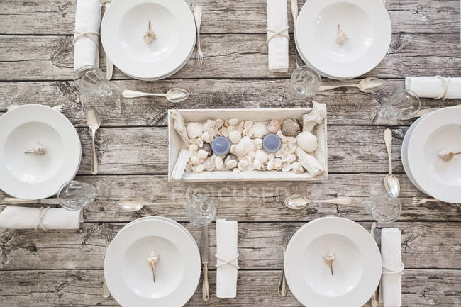 Top view of maritime laid table with place settings — Stock Photo
