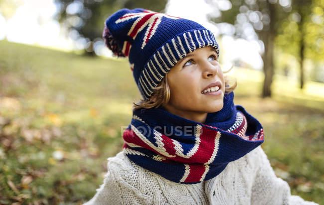 Portrait of blond boy wearing fashionable knit wear in autumn — Stock Photo