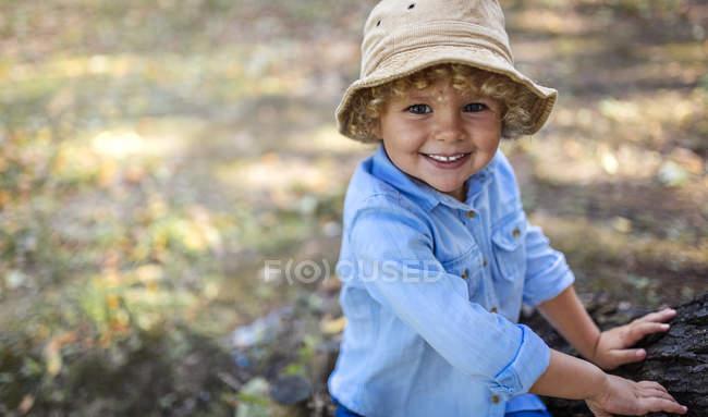 Portrait of smiling blond little boy wearing hat — Stock Photo