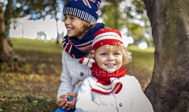 Portrait of two blond boys wearing fashionable knit wear in autumn — Stock Photo