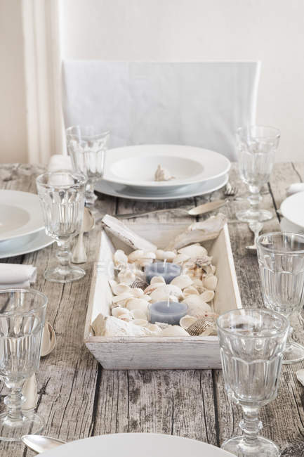 Maritime decorated laid table with wine glasses — Stock Photo