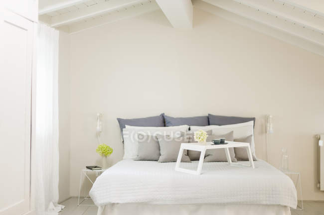 Empty Bed With Breakfast Tray Interior Design Of Bedroom Stock Photo