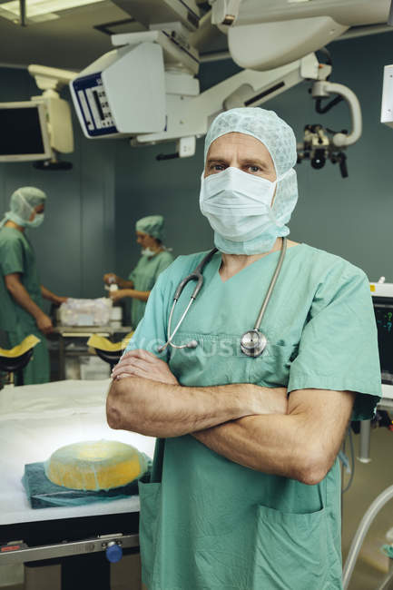 Portrait of confident surgeon in operating room — Stock Photo