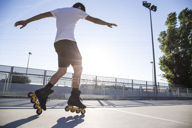 Man with rollerblades during skating session — Stock Photo
