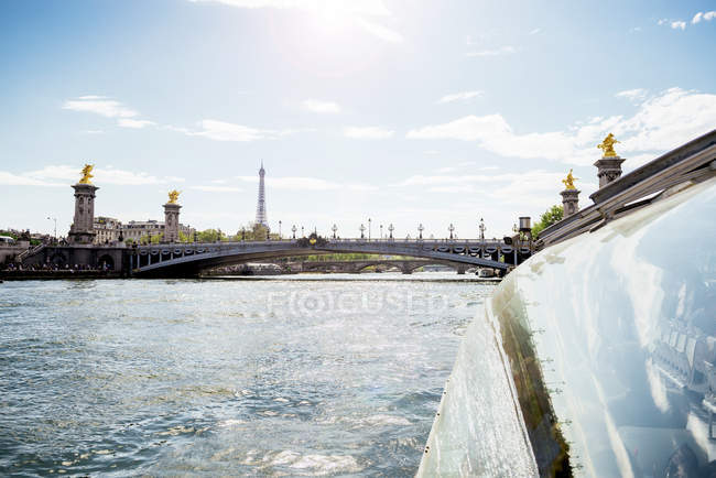 France, Paris, tourboat on Seine River with Pont Alexandre III and the Eiffel Tower in the background — Stock Photo