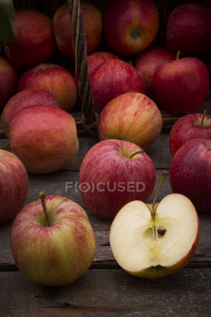 Fresh whole red apples with half — Stock Photo