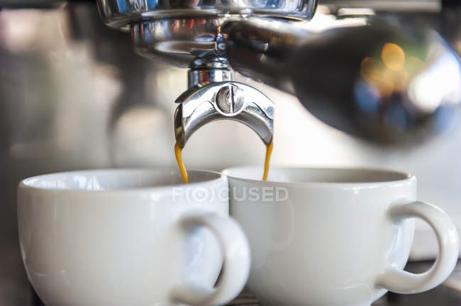 Coffee machine preparing two cups of coffee — Stock Photo