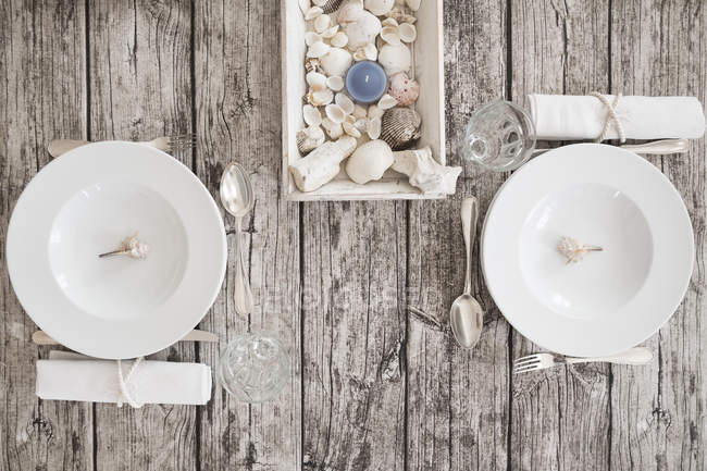 Two place settings on maritime laid table — Stock Photo