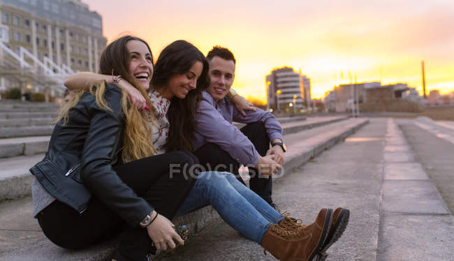 Three friends having fun together at sunset — Stock Photo