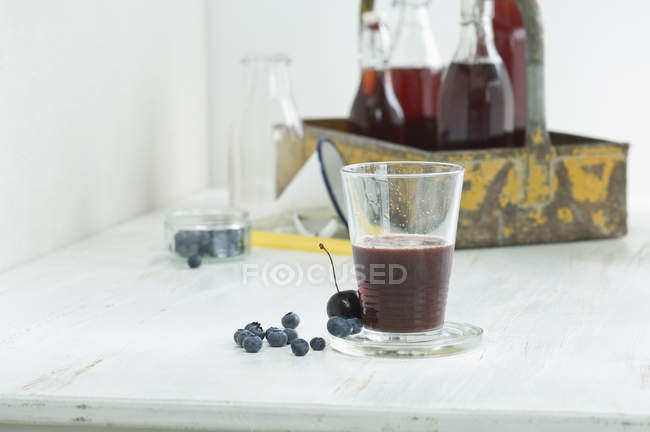 Blueberry smoothie with cherry juice — Stock Photo