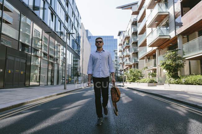 Businessman walking on street — Stock Photo