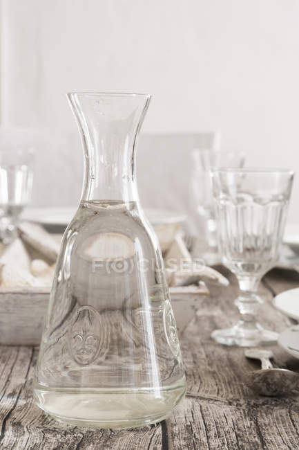 Close up of Water carafe on laid table — Stock Photo