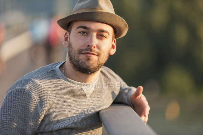 Portrait of bearded young man wearing hat — Stock Photo
