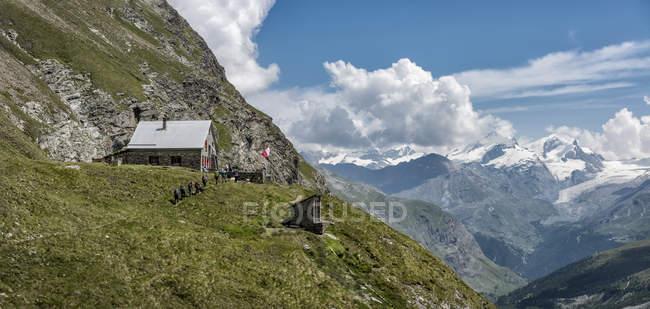 Switzerland, Hikers at Schonbiel hut — Stock Photo