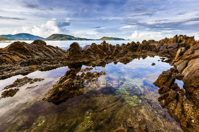 Thailand, Pukhet, seascape with rock over water  during daytime — Stock Photo