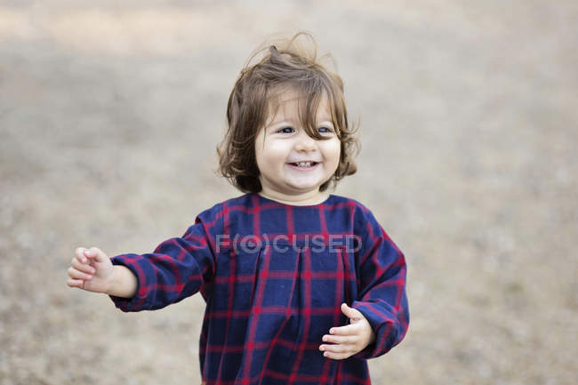 Portrait of smiling happy toddler dancing — Stock Photo