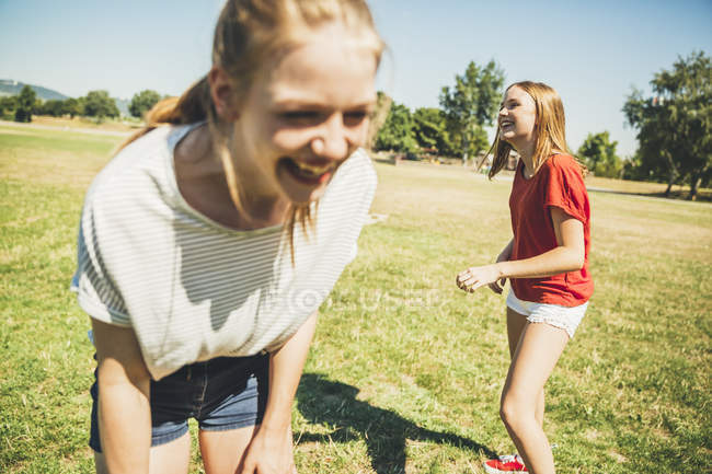 Two teenage girls having fun in park — Stock Photo