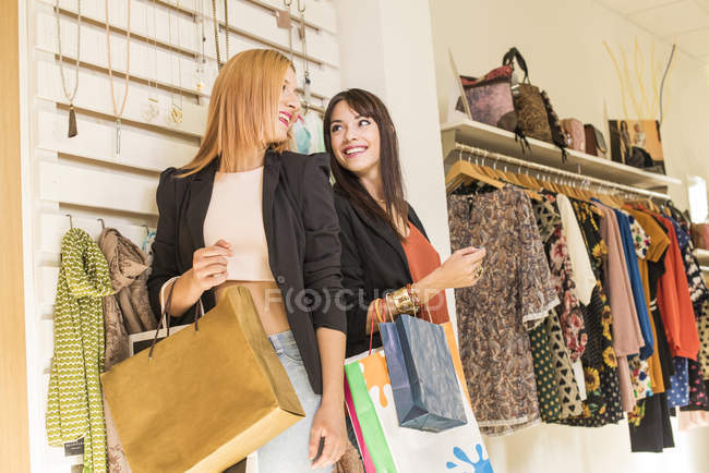 Young women in fashion boutique having fun — Stock Photo
